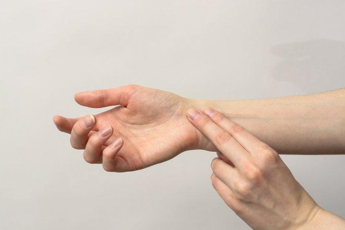 Medicine health care. Female hand checking pulse on wrist