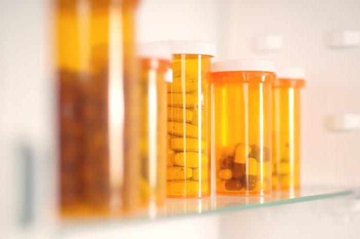 Bottles of pills in a medicine cabinet