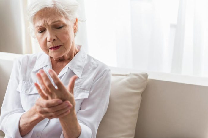 Older woman rubbing her hand