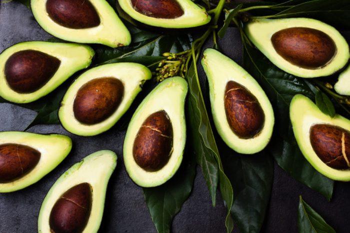 avocado halves with pits
