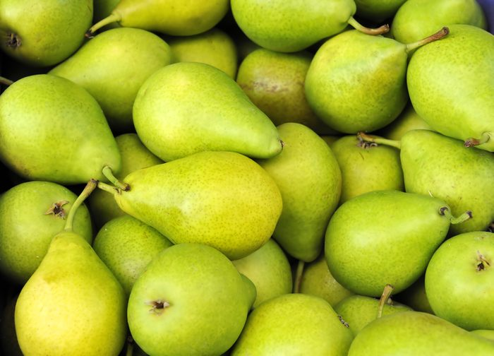 Green pears at a famers market in France