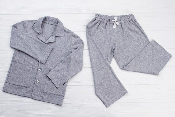 Boys' pajama set on white. Soft gray melange cotton. Loose-fitting shirt and pants for comfort rest at night.