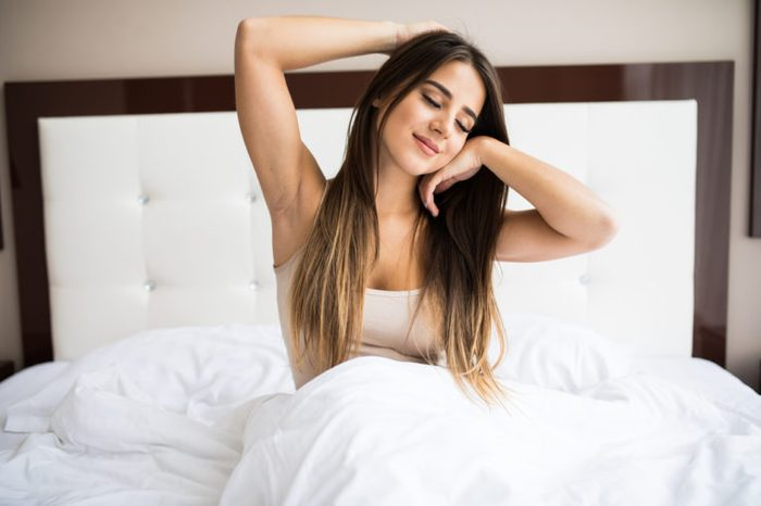 Good morning!!! Young beautiful girl wake up in the morning at home