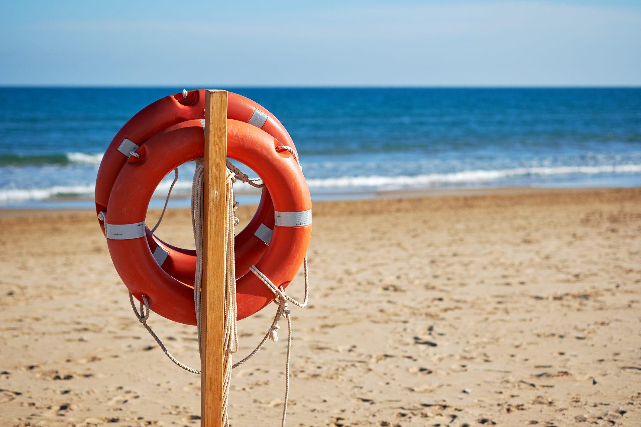 life buoys on the beach in the summer