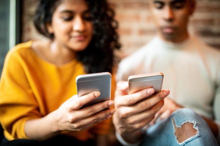 friends looking at social media on phones