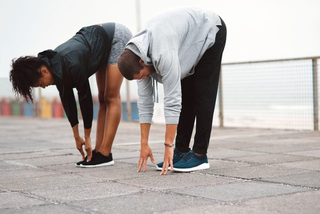 two people stretching