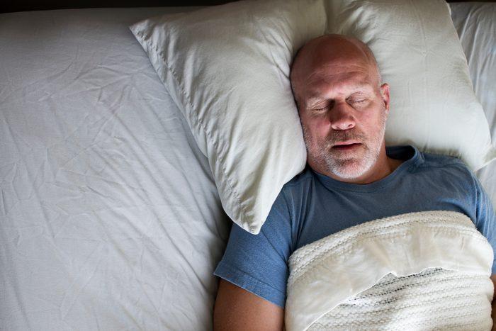 overhead photo of a man sleeping