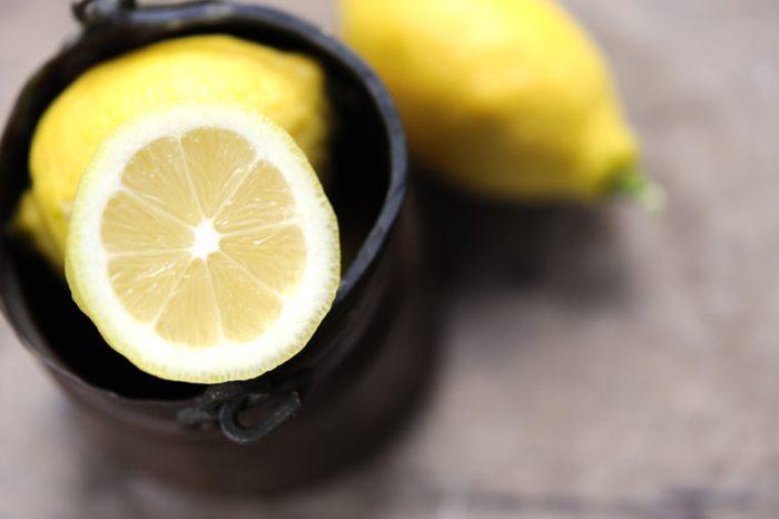 Jar of yellow lemons.