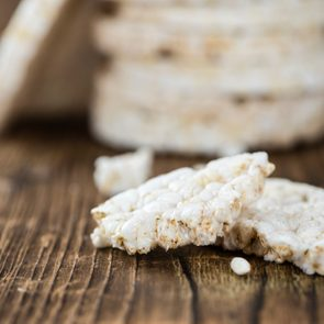 Old wooden table with Rice Cakes (detailed close-up shot)