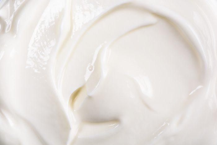 Fresh White Yogurt Background Closeup