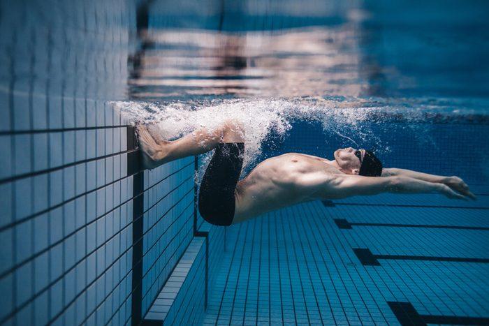 man swimming to keep brain healthy