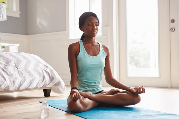 woman doing yoga for brain health