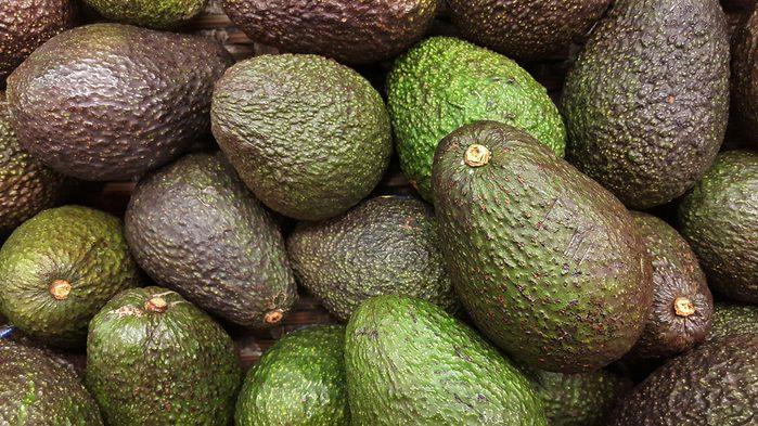pile of green avocados