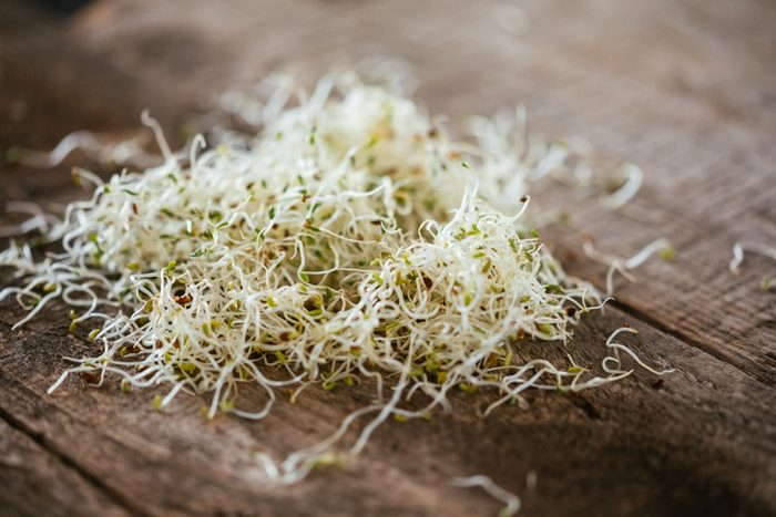 Fresh Alfalfa Sprouts On A Wooded Table