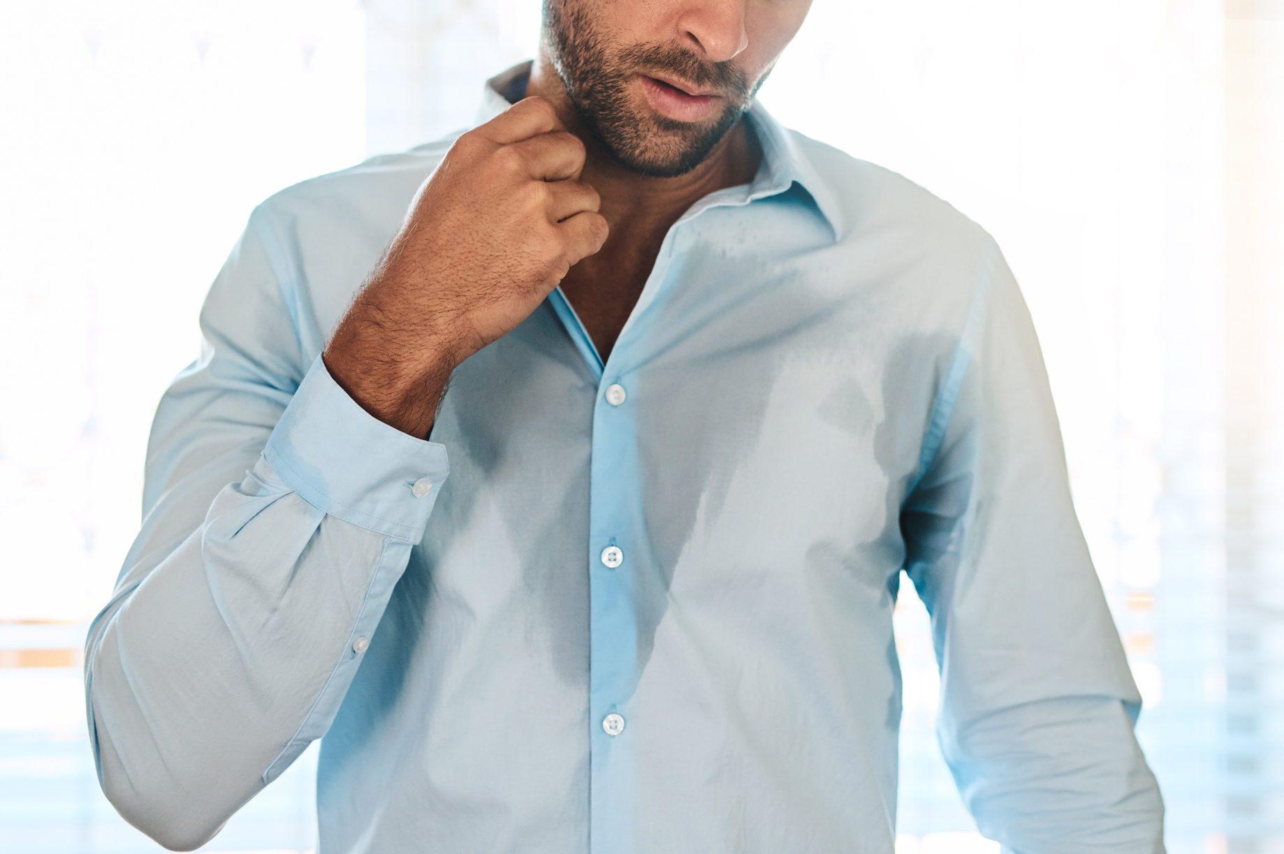 man sweating through shirt