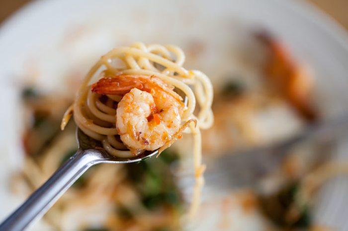 shrimp pasta on fork