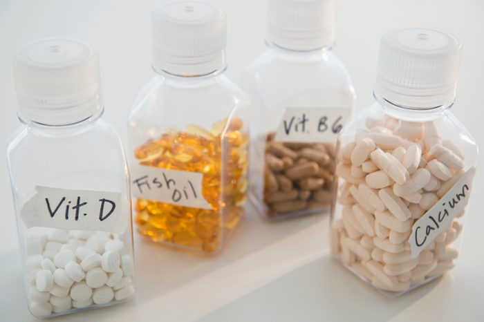 various vitamins and supplements in containers