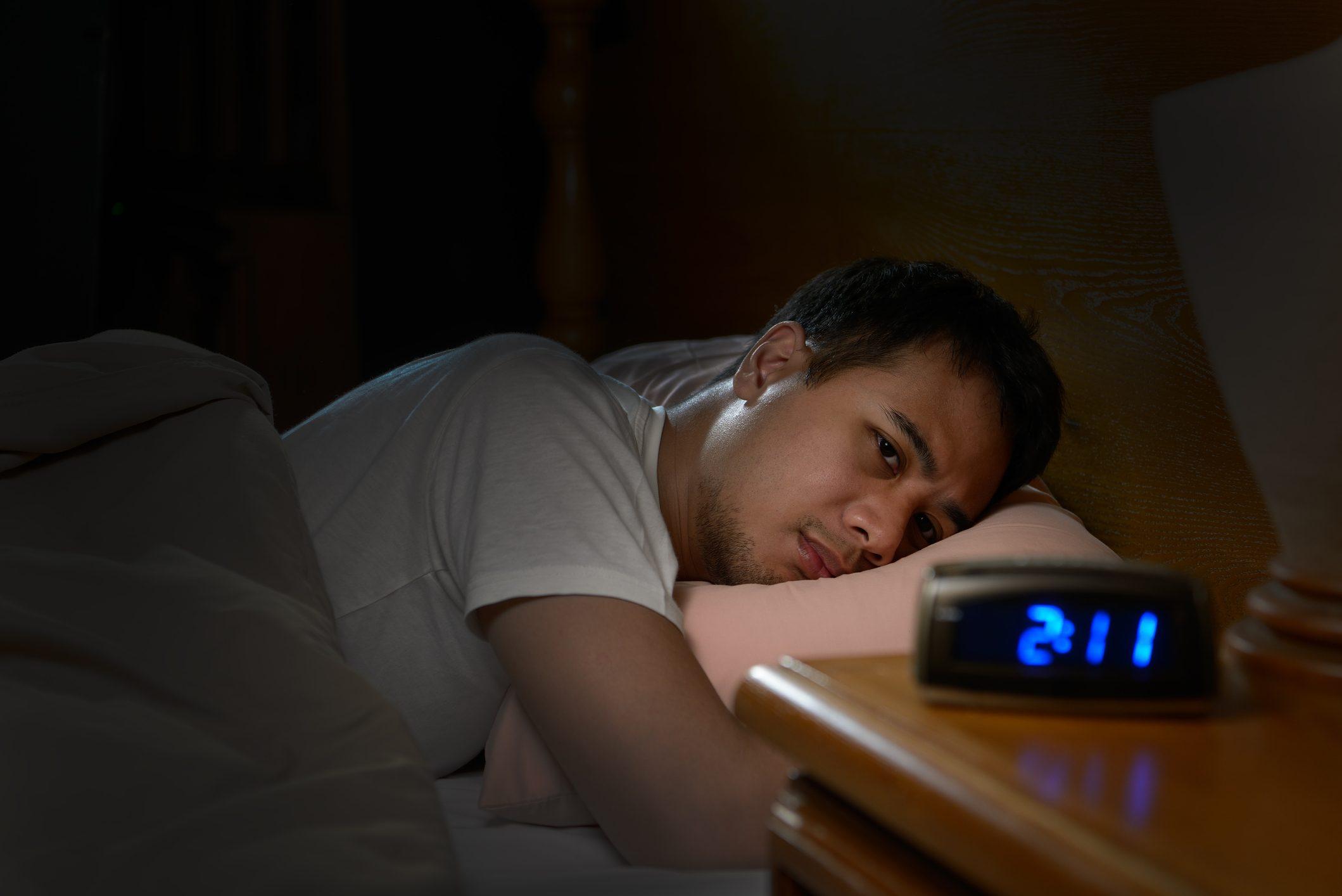 man unable to sleep at night