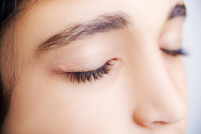 woman with eyes closed, eyelashes and eyelid