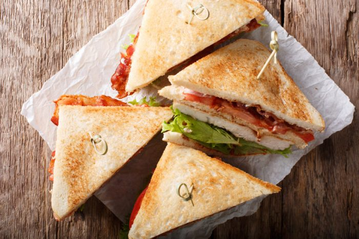 Club sandwiches with lettuce, chicken, and bacon