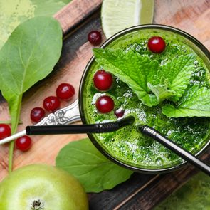 Blended green smoothie drink with spinach and apple