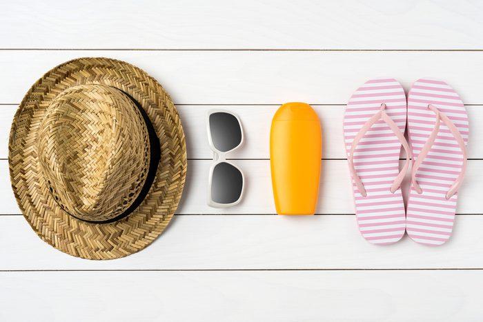 straw hat, sunglasses, sunblock, flipflops