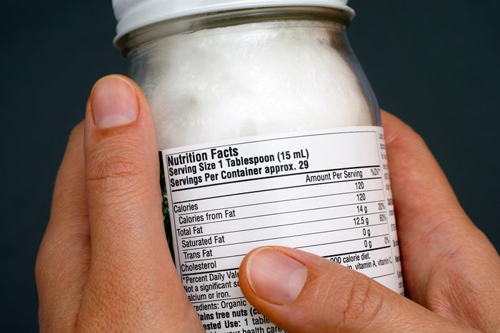 hands holding jar with nutrition facts label
