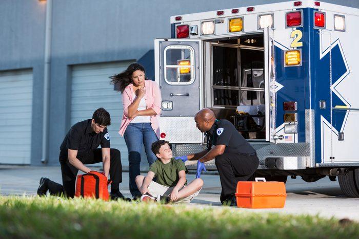 medical emergency with paramedics and ambulance