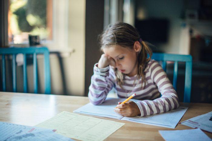young girl doing homework