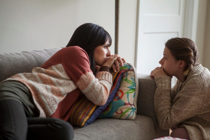 mother and daughter having a conversation at home