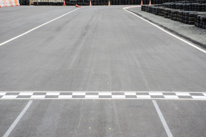 Motor race starting line on asphalt
