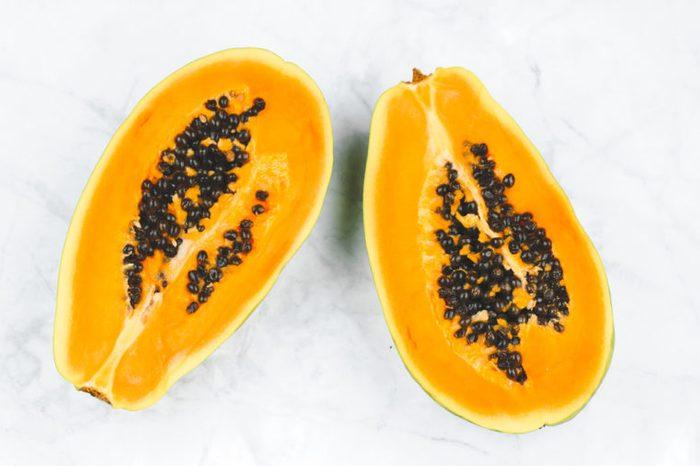 Fresh papaya cut in a half