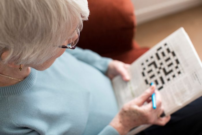 Senior Woman Doing Crossword Puzzle for aging brain