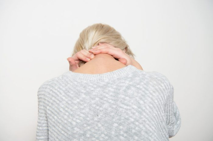 woman with bad chronic neck pain