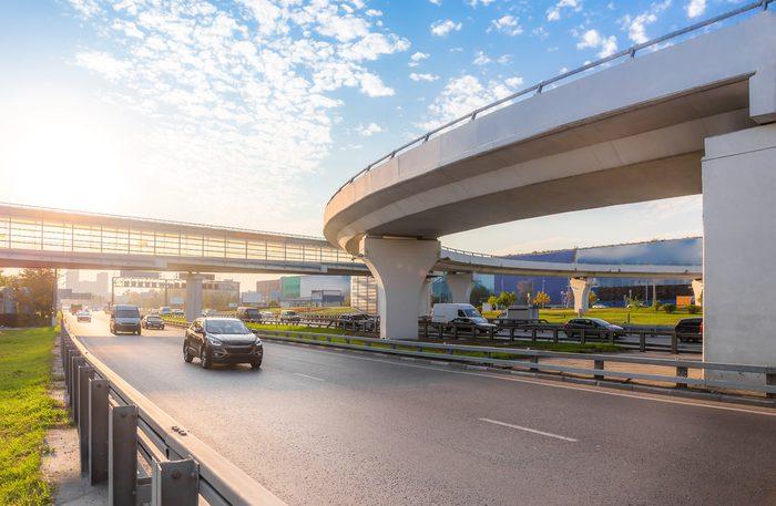 Highway interchange with bridge on the background