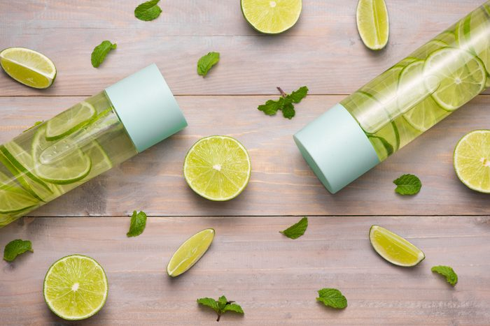 Water with Lime and Mint in Sports Bottle, with slices of lime.