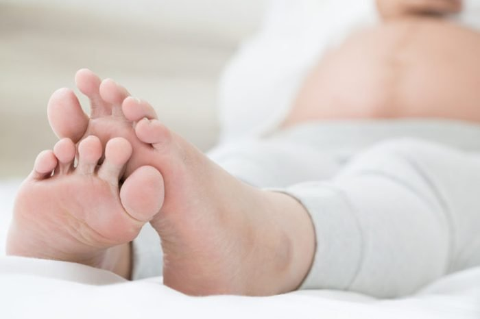 Pregnant woman with swollen feet