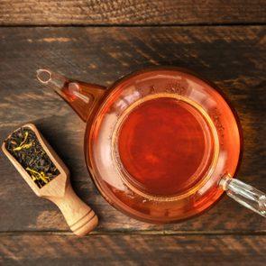 herbal tea pot on wood