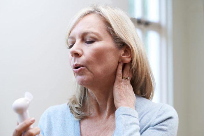 Mature Woman Experiencing Hot Flash From Menopause