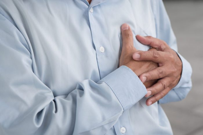 senior man heart attack, hand holding chest
