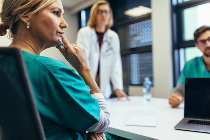 Female medical professional in meeting with colleagues. Doctor during meeting in the conference room.