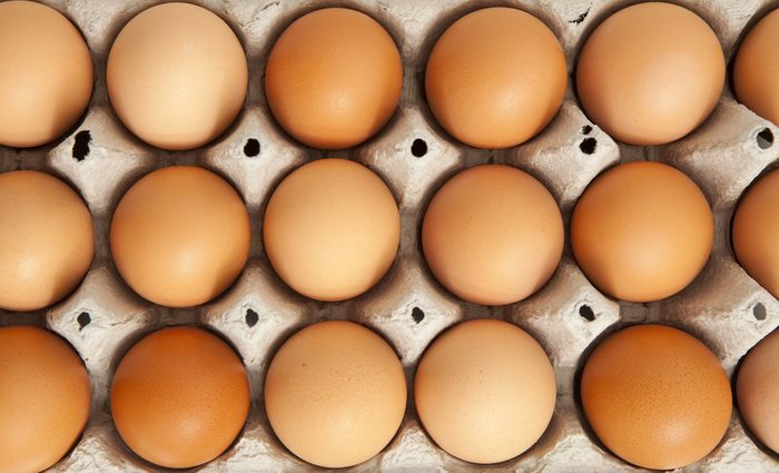 top view of organic eggs in a protective container