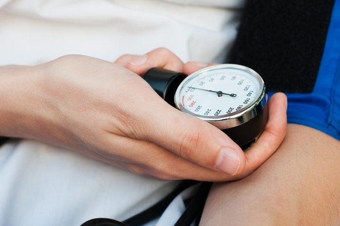 blood pressure gauge in hands