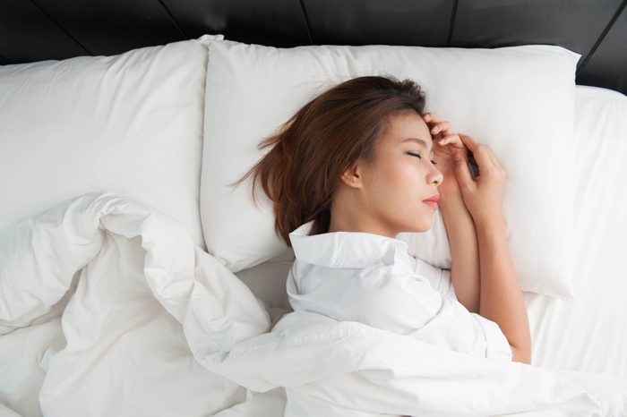 Soft and relaxing pillow,Asian girls are sleeping in a comfortable bed