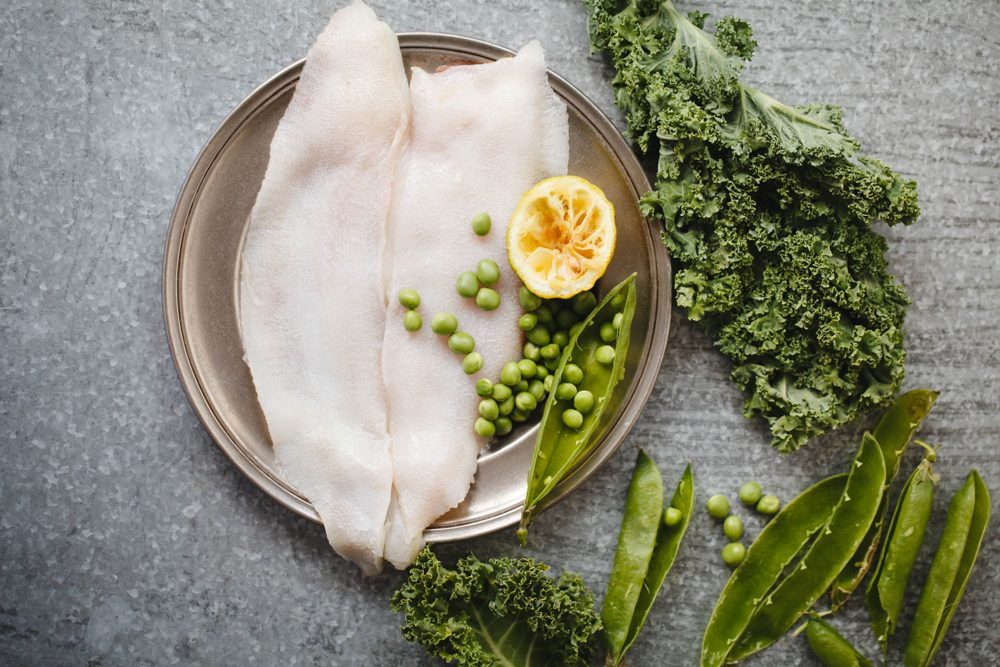 Megrim fish fillet raw fish meat with green vegetables quinoa Clean eating, dieting vegetarian raw food