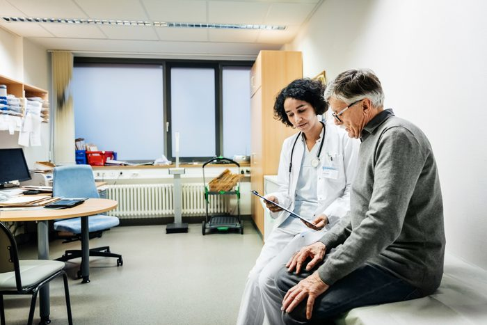elderly man talking to his doctor about test results