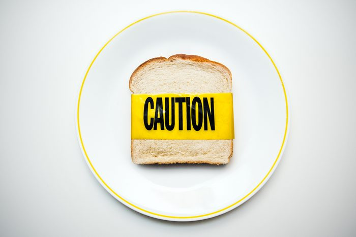 bread on plate with caution tape shot from above