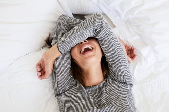 laughing woman girl in bed queef