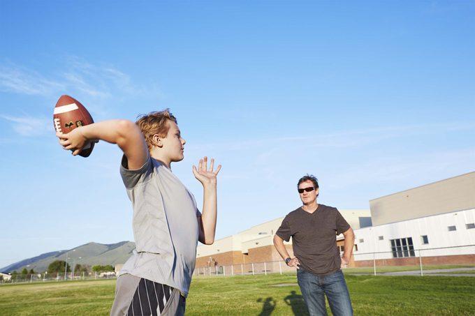 Broghan throwing football