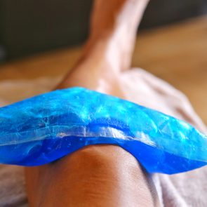 Use a cool bag to treat a knee injury.